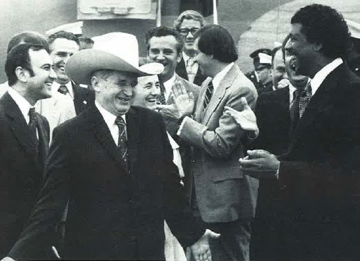 Ceausescu receives a cowboy hat from the Mayor Deputy of Houston, Judson Robinson